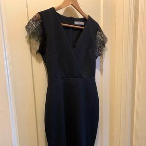 Black midi dress with eyelash lace trim. Worn once
